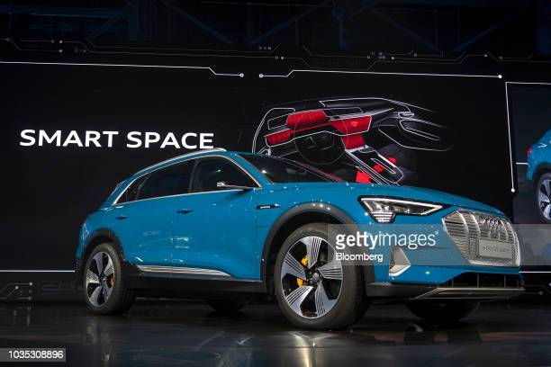The new Audi AG ETron allelectric sport utility vehicle stands during a launch event in Richmond California US on Monday Sept 17 2018 Audiunveiled...