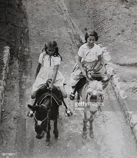 The new Austrian Embassy in Ankara based on a design by Clemens Holzmeister . The two daughters of the embassador on their return from a horse ride....