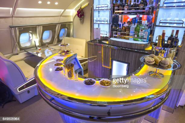 The new bar area for the Emirates Airlines A380 aircraft sits on display as it is unveiled to the trade and media during the ITB Travel Fair in...