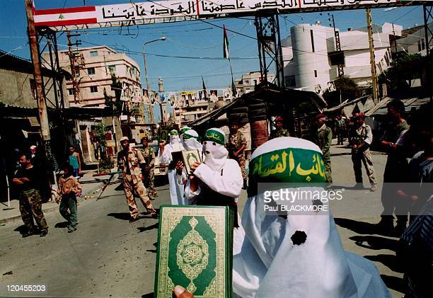 The new Beirut in Lebanon on October 10, 2002 - Ain el-Hilweh .Suicide bombers from Hamas march in celebration of their anniversary. It is the...