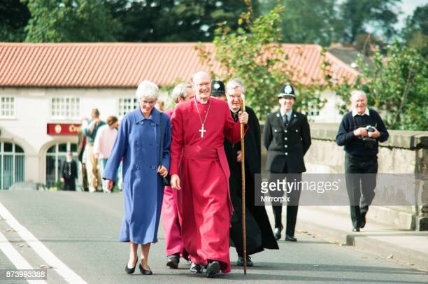 The new Bishop of Durham Rev Michael Turnbull at Croft near Darlington He is pictured crossing the bridge in the village 28th September 1994