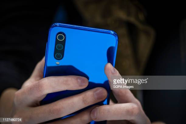 The new blue color model of Xiaomi 9 is seen during the MWC2019. The MWC2019 Mobile World Congress opens its doors to showcase the latest news of the...