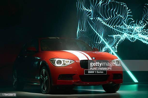 The new BMW 1 Series is displayed during the launch in Mumbai on September 3 2013 India's car sales slid by over seven percent in July marking a...