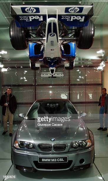 The new BMW M3 CSL is displayed at the 73rd Geneva International Motor Show March 5 2003 in Geneva Switzerland Hanging above the roof is a...