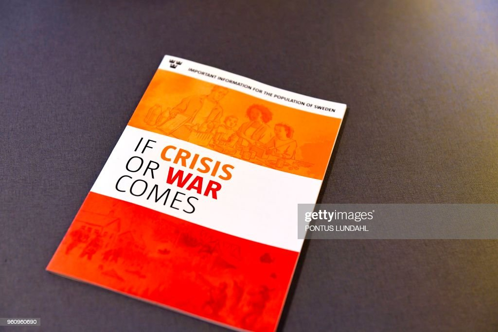 The new brochure 'If Crisis or War Comes' of Swedish Civil Contingencies Agency is pictured during a press conference in Stockholm, on May 21, 2018. - The Swedish government on Monday, May 21, 2018, presented an emergency pamphlet to prepare citizens in the event of a war, natural disaster or cyber attack amid soaring tensions between Russia and the Western allies. (Photo by Pontus LUNDAHL / TT News Agency / AFP) / Sweden OUT