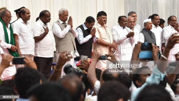The new cabinet ministers of Karnataka with the Governor of Karnataka Vajubhai Vala Chief Minister Kumarswamy and Deputy Chief Minister Parmeshwara...