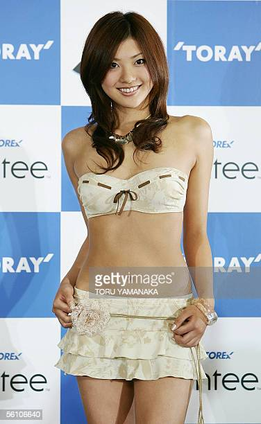 The new campaign girl for Japanese apparel giant Toray Mai Yamagishi displays a tube top bikini and miniskirt during Toray's 2006 swimsuit collection...