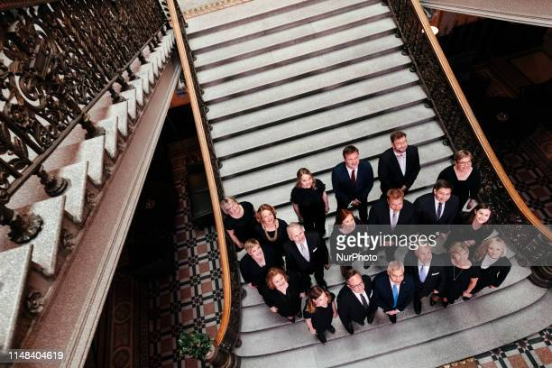 The new centreleft coalition government was sworn in Ministers of the new Finnish government pose for a group photo during a press briefing at the...