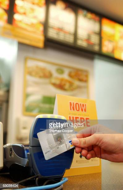 The new Chase Bank credit card with blink technology is displayed during a press conference at an Arby's restaurant June 8 2005 in Denver Colorado...
