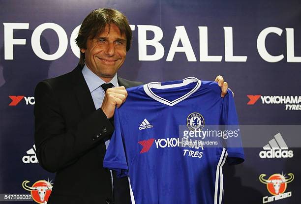 The new Chelsea Manager Antonio Conte holds up a Chelsea shirt during a press conference at Stamford Bridge on July 14 2016 in London England