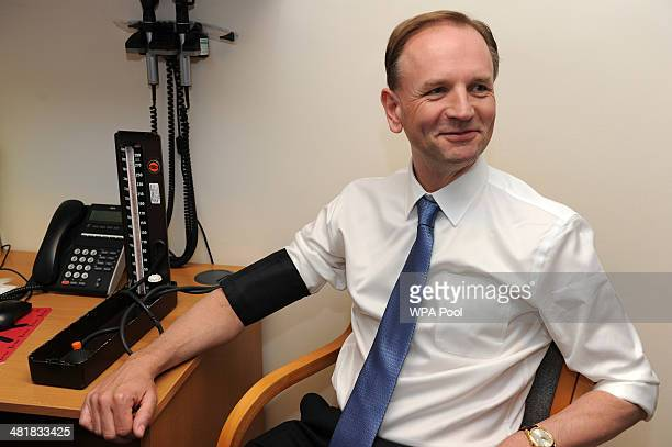 The new chief executive of NHS Simon Stevens has his blood pressure taken at Consett Medical Centre in County Durham on April 1 2014 in Consett...