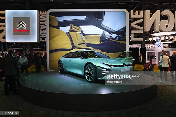 The new Citroen Cxperience concept automobile, manufactured by the PSA Group, sits on display during the second press day of the Paris Motor Show at...
