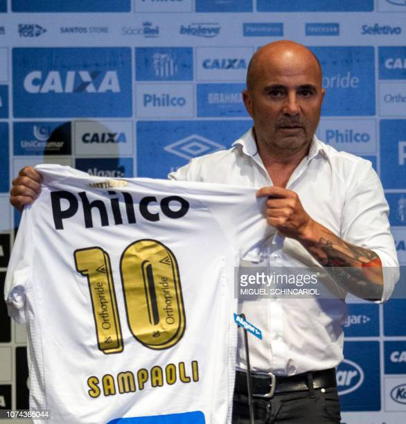 The new coach of Brazilian football team Santos, Argentine Jorge Sampaoli, poses with the team jersey during his presentation in Sao Paulo, Brazil,...