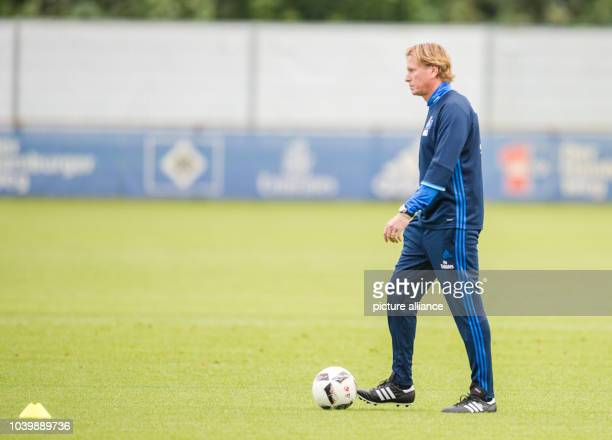 The new coach of German Bundesliga club Hamburger SV Markus Gisdol on the pitch during his first training session in Hamburg Germany 26 September...