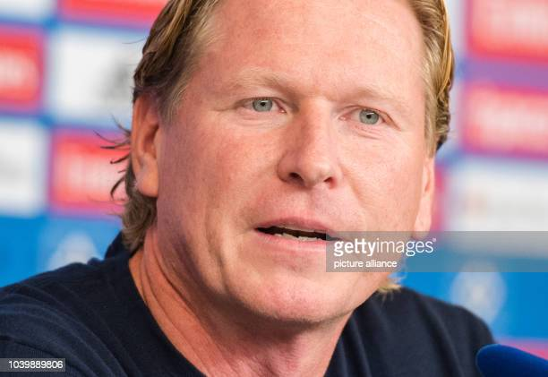 The new coach of German Bundesliga club Hamburger SV Markus Gisdol speaks at a press conference for his introduction in Hamburg Germany 26 September...