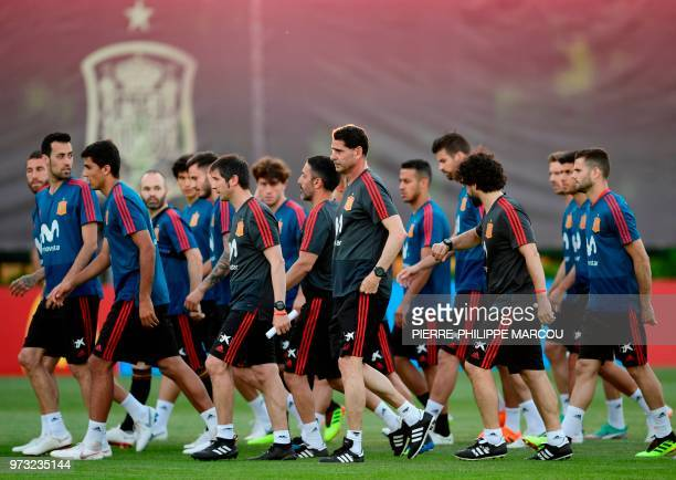 The new coach of the Spanish national football team Fernando Hierro attends a training session with Spain's players at Krasnodar Academy on June 13...
