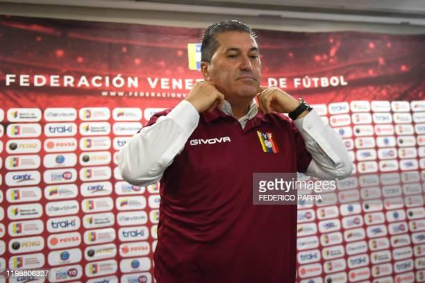 The new coach of the Venezuelan national football team Portuguese Jose Peseiro wears the Venezuelan national soccer team jersey during a press...