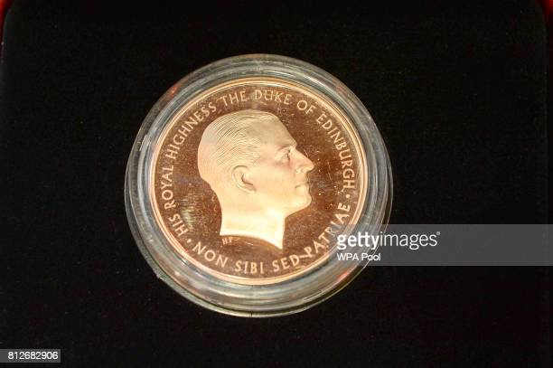 The new commemorative £5 coin celebrating the Duke of Edinburgh's lifetime in the public service that the Prince of Wales struck himself during a...