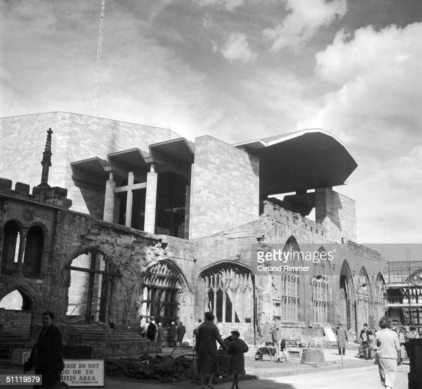 The new Coventry Cathedral and the ruins of the original structure, which was largely destroyed in World War II, 23rd May 1962.