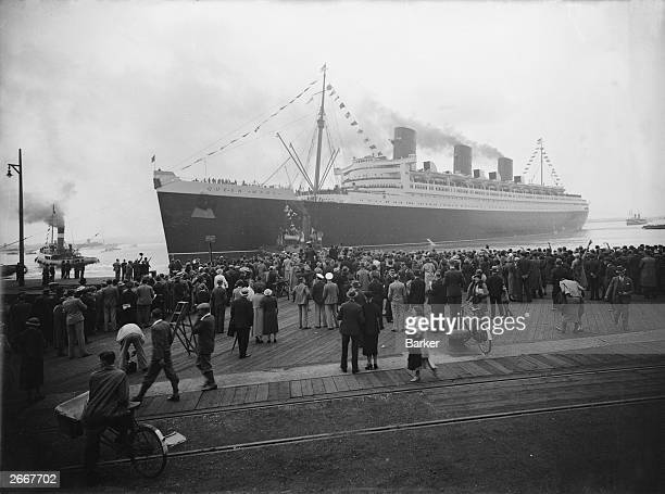 The new Cunard White Star liner Queen Mary pulls away from Southampton at the start of her maiden voyage across the Atlantic to New York