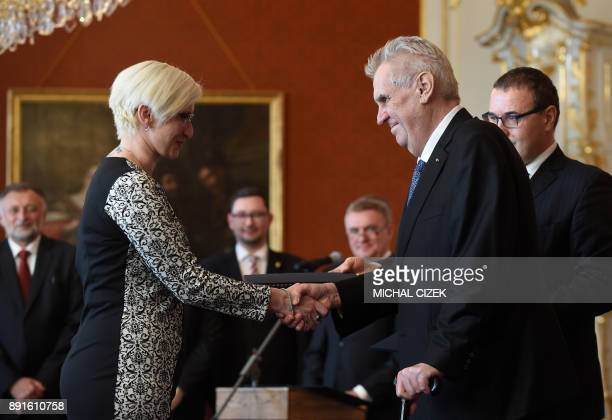 The new Czech Defence Minister Karla Slechtova of the ANO party shakes hands with Czech President Milos Zeman after she was appointed on December 13...