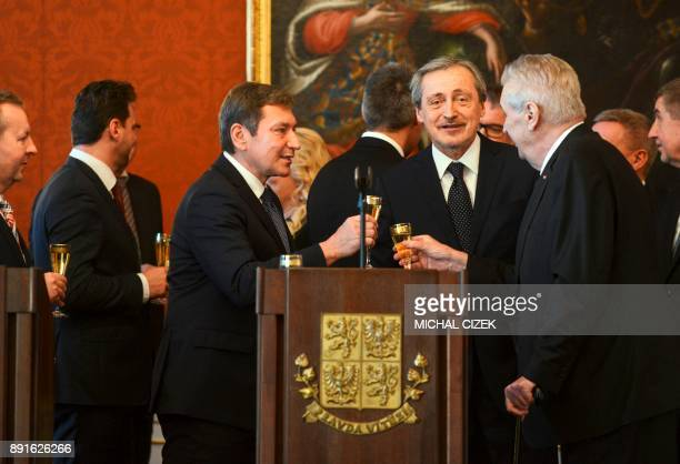 The new Czech foreign Minister Martin Stropnicky of the ANO party and Czech President Milos Zeman toast after the President appointed a new cabinet...