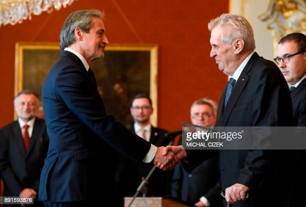 The new Czech Foreign Mister Martin Stropnicky of the ANO party shakes hands with Czech President Milos Zeman after he was appointed on December 13...