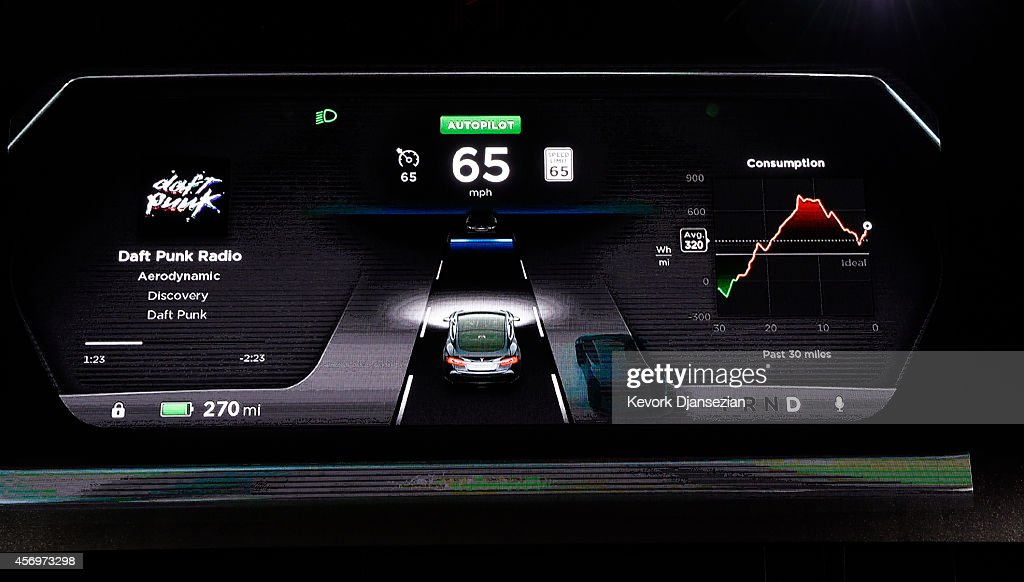 The new dashboard of Tesla 'D' model electric sedan is seen on a giant screen during Elon Musk's , CEO of Tesla, unveiling of the dual engine chassis of the new Tesla 'D' model, a faster and all-wheel-drive version of the Model S electric sedan, at the Hawthorne Airport October 09, 2014 in Hawthorne, California. The D will be able to accelerate to 60 miles per hour in just over 3 seconds.