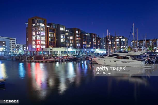 the new development of portishead marina at dusk - portishead stock pictures, royalty-free photos & images