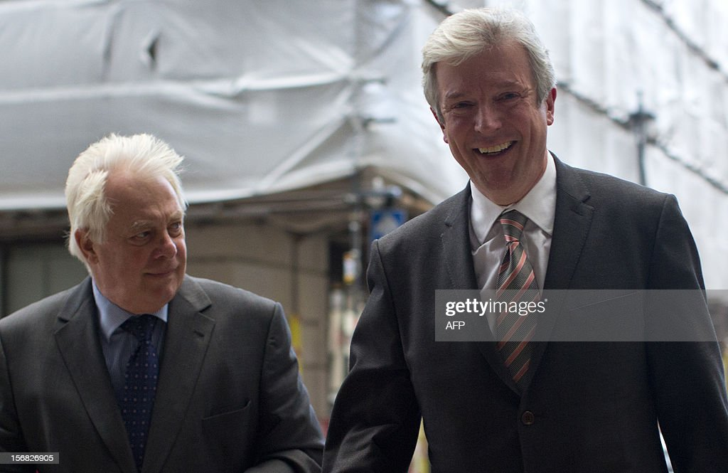 The new director-general of the BBC Tony Hall (R) walks with Chris Patten (L), the head of the BBC Trust, from his car to a press conference in London on November 22, 2012. Tony Hall, the chief executive of Britain's Royal Opera House, was Thursday named director-general of the BBC after his predecessor quit over the corporation's reporting of child sex abuse.