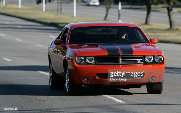 The new Dodge Challenger is driven down Woodward Avenue during the 2006 Woodward Dream Cruise in Royal Oak Michigan Tuesday August 15 2006