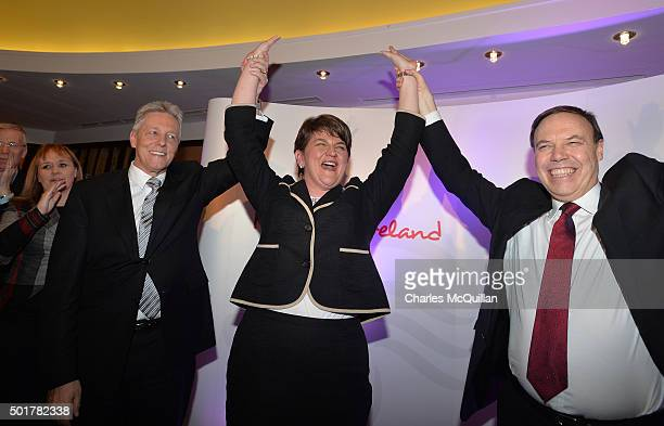 The new DUP leader Arlene Foster is congratulated by outgoing leader Peter Robinson and deputy leader Nigel Dodds at the Park Avenue hotel after the...