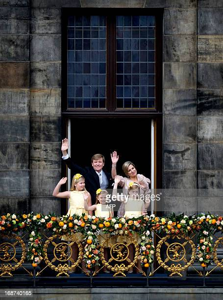 The New Dutch King Willem-Alexander, Queen Maxima and their daugthers Crown Princess Amalia, Princess Ariane and Princess Alexia wave on the balcony...