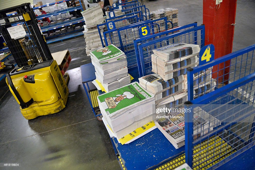 The new edition of Charlie Hebdo is prepared for delivery in a press distribution center in the suburbs on January 14, 2014 in Marne-la-Vallee, France. Three million copies of the controversial magazine have been printed in the wake of last week's terrorist attacks. A second delivery of the magazine is scheduled for tomorrow.