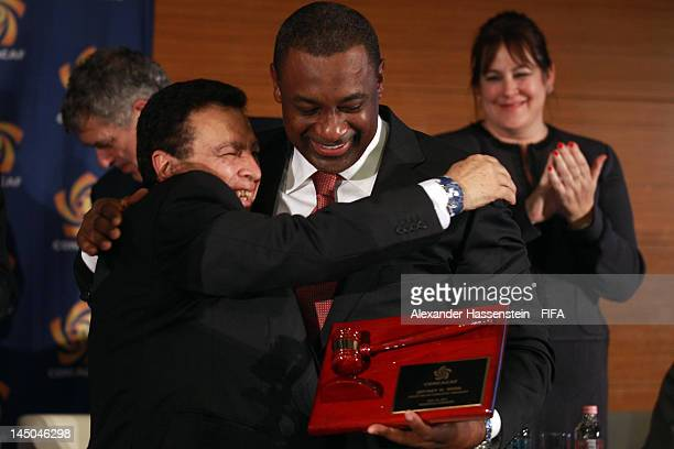 The new elected CONCACAF President Jeffrey Webb reveives a gift from acting President Alfredo Hawit during the CONCACAF extraordinary congress at...