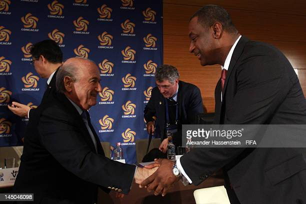 The new elected CONCACAF President Jeffrey Webb shake hands with FIFA President Joseph S Blatter during the CONCACAF extraordinary congress at...