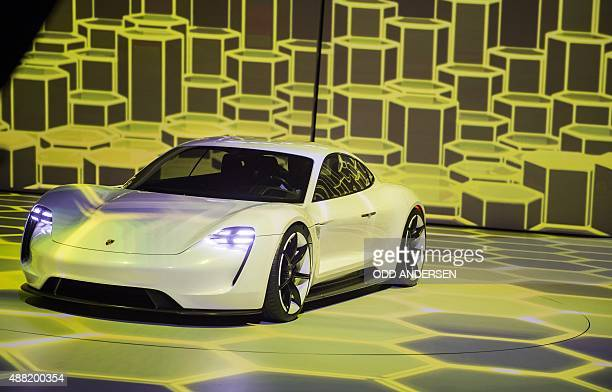 The new electric Porsche Mission E concept car is presented during the Volkswagen group night at the Fraport arena prior to the 66th IAA auto show in...
