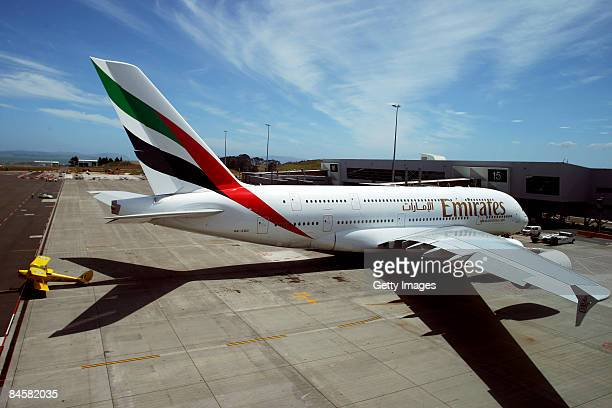 The new Emirates A380 is in sharp contrast to a 1930's Tiger Moth after the superjumbo's inaugural touchdown at Auckland Airport to begin a...