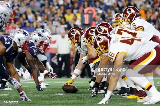 The New England Patriots and the Washington Redskins face off during their preseason game at Gillette Stadium on August 9 2018 in Foxborough...