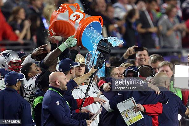 The New England Patriots celebrate late in the game with head coach Bill Belichick of the New England Patriots against the Seattle Seahawks during...