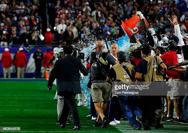 The New England Patriots celebrate late in the game with head coach Bill Belichick during Super Bowl XLIX at University of Phoenix Stadium on...