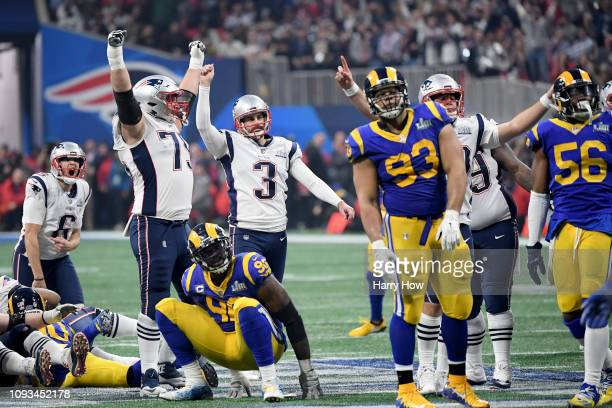 The New England Patriots celebrate with Stephen Gostkowski after Gostkowski's field goal during the fourth quarter of Super Bowl LIII against the Los...
