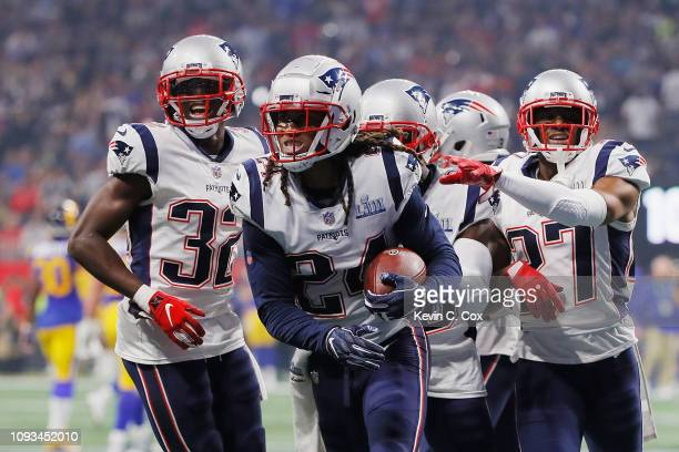 The New England Patriots celebrate with Stephon Gilmore after Gilmore makes an interception in the fourth quarter during Super Bowl LIII against the...