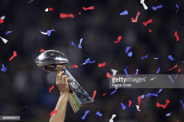 The New England Patriots celebrate with the Vince Lombardi Trophy after defeating the Atlanta Falcons during Super Bowl 51 at NRG Stadium on February...