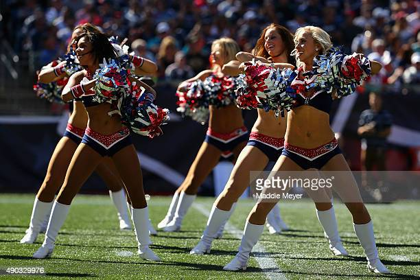 The New England Patriots cheerleaders perform during the game against the Jacksonville Jaguars at Gillette Stadium on September 27 2015 in Foxboro...