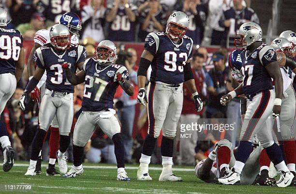 The New England Patriots' Ellis Hobbs celebrates after stopping the New York Giants in the first quarter of Super Bowl XLII at University of Phoenix...