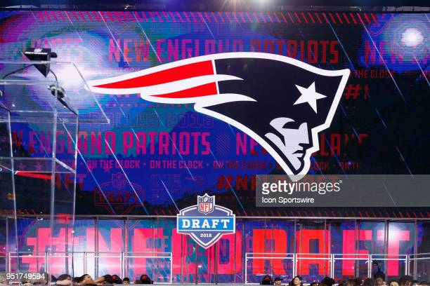 The New England Patriots logo is displayed while on the clock during the first round of the NFL Draft on April 26 2018 at ATT Stadium in Arlington TX