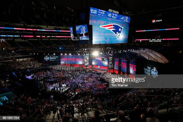 The New England Patriots logo is seen on a video board during the first round of the 2018 NFL Draft at ATT Stadium on April 26 2018 in Arlington Texas