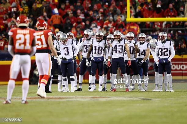 The New England Patriots look on before a play against the Kansas City Chiefs in the second half during the AFC Championship Game at Arrowhead...