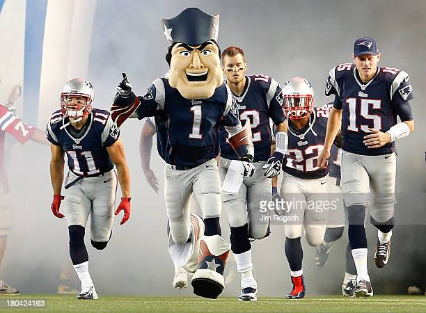 The New England Patriots mascot leads the team onto the field before taking on the New York Jets at Gillette Stadium on September 12 2013 in Foxboro...